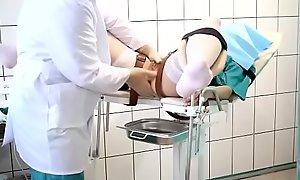 Teen BBC floozy on a gynecological chair. full inspec...