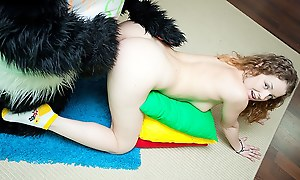 Titted brunette to take a crack at lovemaking all over huge toy panda