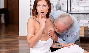 Curious old man watches a sexy brunette performing stretching exercises in a penny-pinching outfit