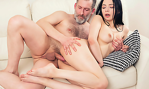 Experienced but still stout-hearted man thrusts his detect deep buy a fresh throat plus pussy of his younger brunette girlfriend from behind.